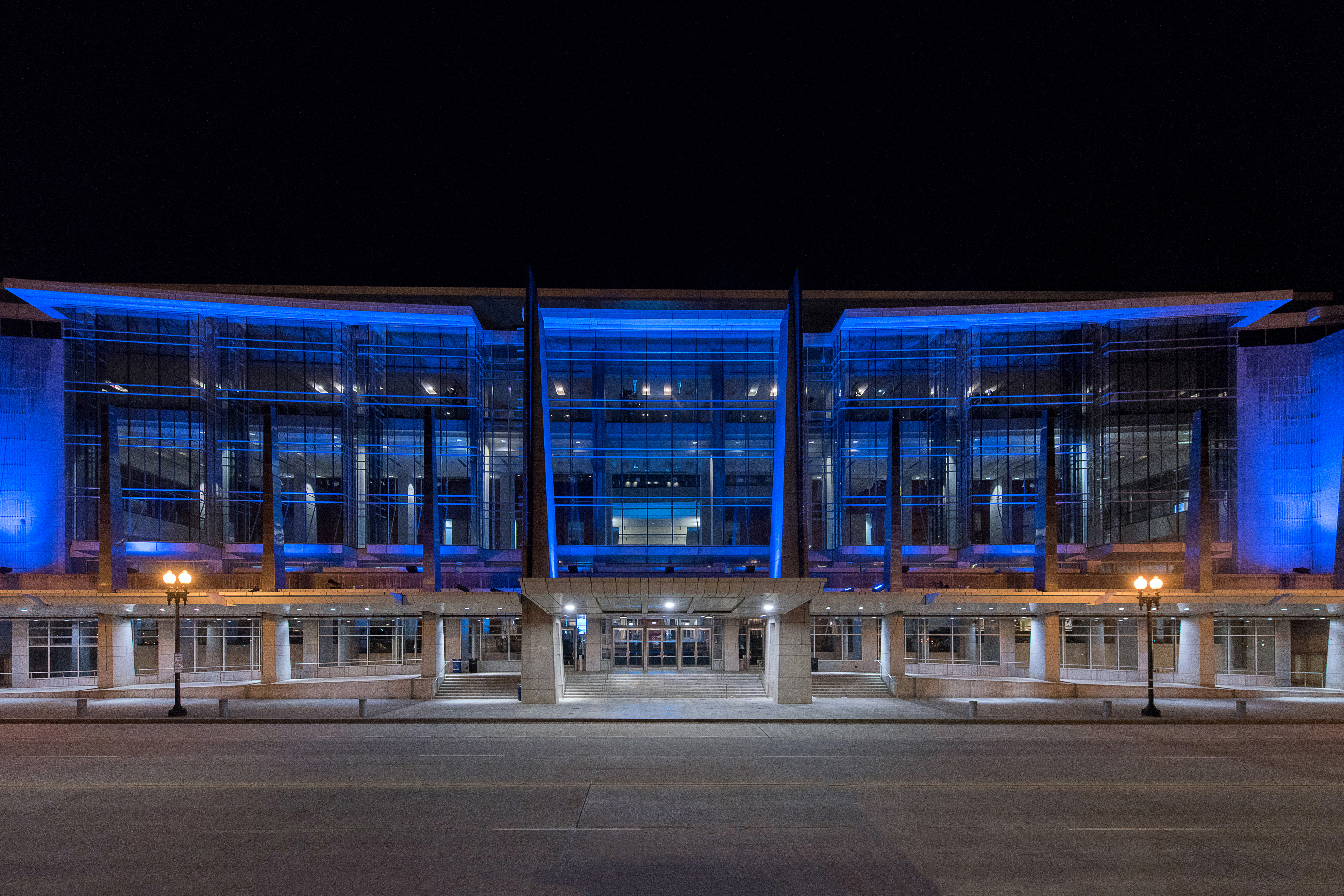Exterior shot of the Walter E. Washington Convention Center lit blue