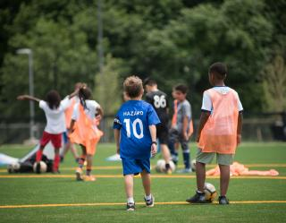 Kids playing at The Fields at RFK Campus opening